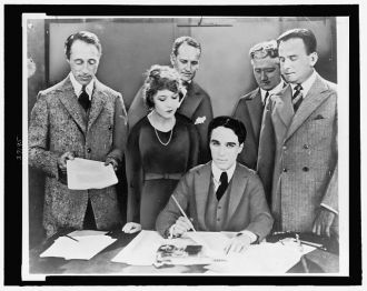 [D.W. Griffith, Mary Pickford, Charlie Chaplin (seated)...