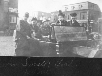 John Small with friends in his Ford