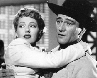 Jean Arthur and John Wayne