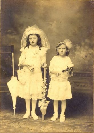Jane and Margaret Lyons. First Communion