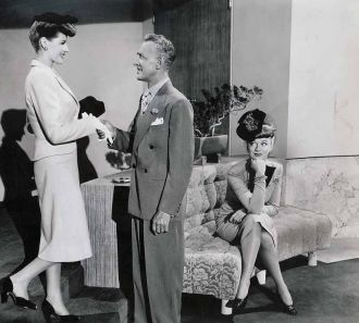 Eve Arden, Otto Kruger and Rita Hayworth