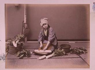 [Girl cutting a Japanese radish]