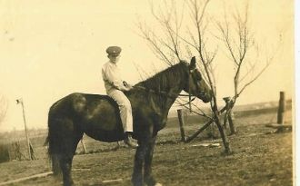 Young Roy E. Neal On His Horse