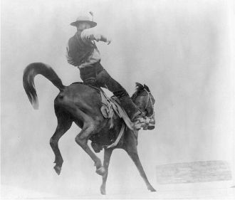 Ned Coy on a bucking bronco