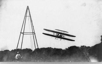 Orville Wright flying