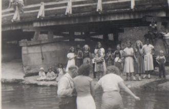 BAPTISING AT THE RIVER