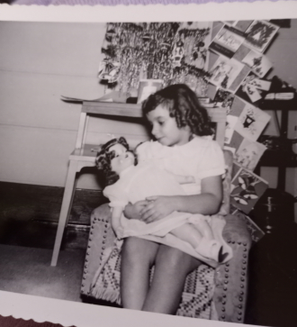 My mom pamela claire Thompson and her many dolls