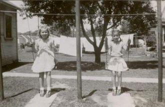 Monica and Nadine Szabo, swinging away.