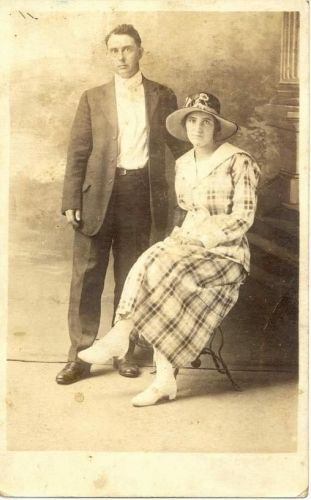 Man Standing & Woman Seated