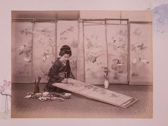 Japanese woman painting screen