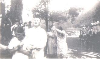 BAPTISING AT THE RIVER 2