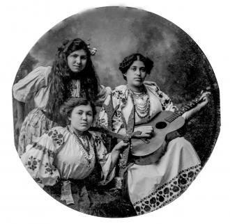 Three ethnic women with guitar