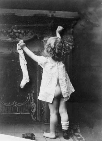 Girl with Stocking on Christmas Eve