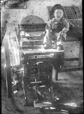 Boy in print shop