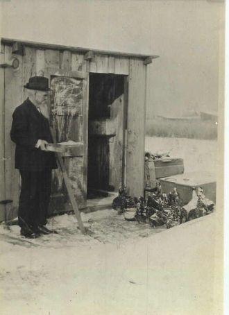 Benton Carl Feeding His Chickens