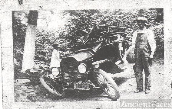 Man with wrecked car
