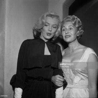 Sheilah Graham and Marilyn Monroe