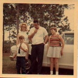 my dad,mom,me and brother  in  fl at xmas