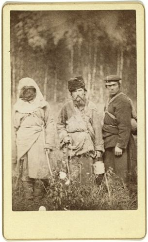 Three run away convicts standing in a field