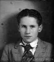 My Dad, Marc William Johnson b. 5-21-1912  d. 2000  Young man, I'd guess 12 to 14 by the looks of his face, shirt, and tie.