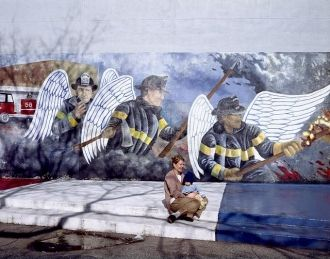 Mother and child at the Chicago firefighter mural,...