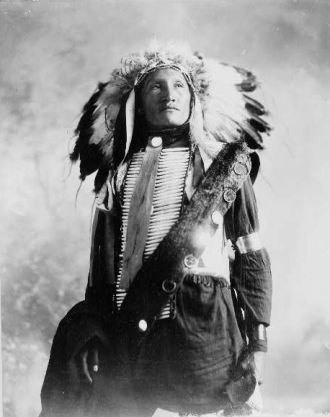 Sioux Indian in feather headdress