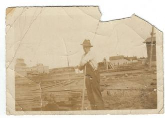 Unknown man working on railroad tracks