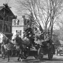 Vintage photo of firemen and their horse-drawn wagon