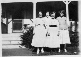 Four Ashenden ladies in front of their porch