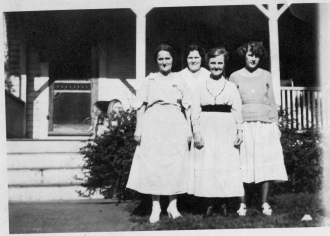 Four Ashenden ladies in front of their porch
