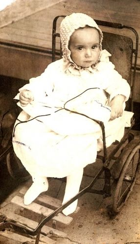 Unknown baby in old buggy in Oklahoma