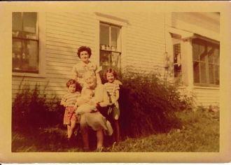 Aunt Annie Hannigan Willette holding Sheila [Maine]