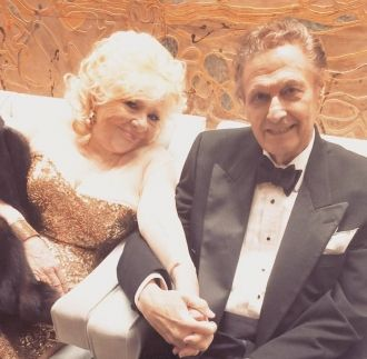 Renee and Joseph Bologna holding hands