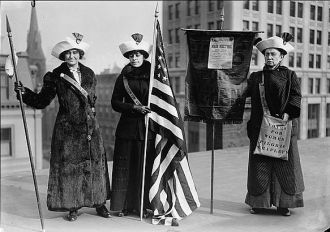 Suffragettes with flag