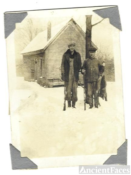 E. V. Moore and Ellis Alley at family home