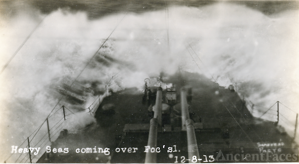Bow of a warship in rough sea
