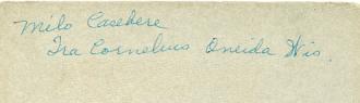 Writing on the back of Ira Cornelius and Milo Casebere photo