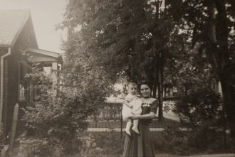 Pearl Stawnychka holding her sister-in-law's baby. Maple trees lined the streets like a canopy back in the 1950s in Hamilton ON.