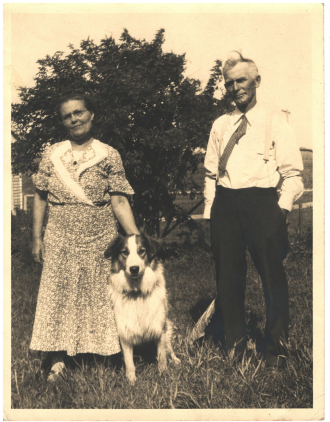 Two people and a dog